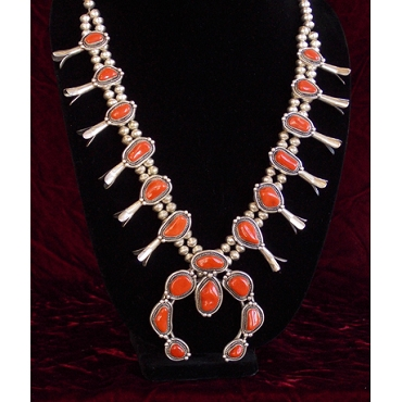 Smooth as Glass and Perfectly Matched Coral set in a Squash Blossom Necklace